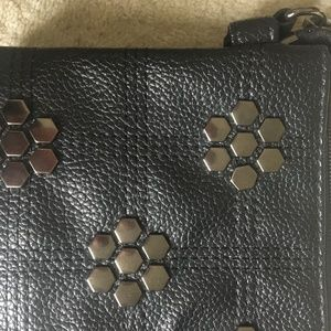 Handbags - NWOT Black purse with metal decoration and strap